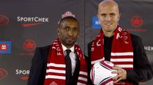 Toronto FC new soccer players Jermain Defoe (left) and Michael Bradley attend a news conference in Toronto, Jan.13, 2014. (Fernando Morales/The Globe and Mail)