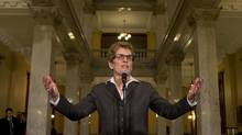 The new Liberal leader and Ontario Premier Kathleen Wynne heads to the microphone to speak to the media before her first caucus meeting at Queen's Park on Jan. 29, 2013. (Peter Power/The Globe and Mail)