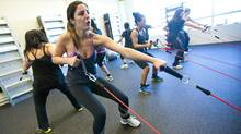 Participants in a FitWall fitness class use resistance pulleys for strenghtening at FitWall in Vaughan, Ontario Monday March 19, 2012. (Tim Fraser for The Globe and Mail/Tim Fraser for The Globe and Mail)