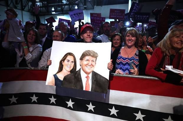 A Trump supporter holds a painting of the Republican candidate and his wife, Melania, at a campaign rally the Reno-Sparks Convention Center in Reno, Nevada, on Nov. 5, 2016. Nevada is a crucial swing state for both candidates.