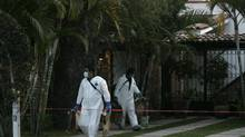Forensic workers work outside a house in Ajijic, near Guadalajara, Mexico, February 9, 2014. Police found the bodies of two Canadians after they were discovered by a gardener inside their house, after an apparent robbery, according to local media. (Alejandro Acosta/REUTERS)