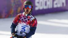Russia's Vic Wild reacts during the men's parallel slalom snowboard finals at the 2014 Sochi Winter Olympic Games in Rosa Khutor February 22, 2014. (LUCAS JACKSON/REUTERS)