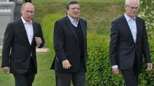 Russian President Vladimir Putin, left, European Commission President Jose Manuel Barroso, centre, and European Council President Herman Van Rompuy walk during the Russia EU Summit outside St. Petersburg, Russia on Sunday, June 3, 2012. (Alexei Nikolsky/THE ASSOCIATED PRESS)