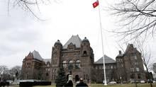 The Ontario provincial flag flies over Queen's Park in Toronto. (Deborah Baic/The Globe and Mail)