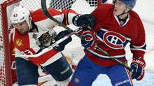 Montreal Canadiens right wing Brendan Gallagher (11) and Florida Panthers defenseman Mike Weaver (43) battle in front of the net during first period National Hockey League action Sunday, December 15, 2013 in Montreal. (RYAN REMIORZ/THE CANADIAN PRESS)