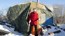 Interim NDP Leader Nycole Turmel steps out of a shelter being used as temporary housing in Attawapiskat, Ont., on Nov. 29, 2011. (Adrian Wyld/Adrian Wyld/The Canadian Press)