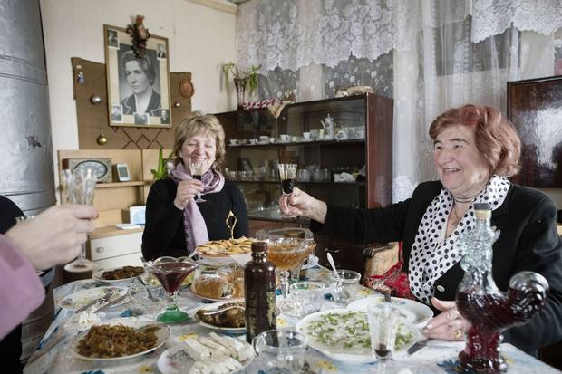 Regina Galasko, right, Piedruja's mayor in the late 1980s, gets her news exclusively from Russian sources. 'Everyone,' she says, 'has their own truth.'