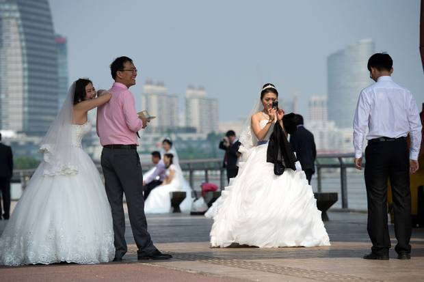 Chinese couples gather for a wedding photo shoot at the West Bund in Shanghai on Sept. 25, 2014.