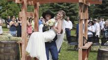 Ryan Neal carried his wife, Tiffany, back down the aisle after they were married on July 5 in Lumby, B.C. (Camillia Courts)