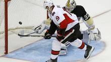 Ottawa Senators' Jason Spezza (19) backhands the game-winning shootout goal past Pittsburgh Penguins goalie Jeff Zatkoff (37) during the NHL hockey game in Pittsburgh, Sunday, April 13, 2014. The Senators won 3-2. (Gene J. Puskar/AP)