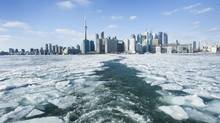 Passengers ride the Toronto Island Ferry on an ice-covered Lake Ontario in Toronto on Jan. 9, 2014. (KEVIN VAN PAASSEN/THE GLOBE AND MAIL)