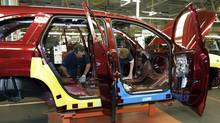 The Cami auto plant in Ingersoll, Ont., already builds the Chevrolet Equinox and GMC Terrain crossovers, but GM had been considering shifting the work to plants in Spring Hill, Tenn., and Ramos Arizpe, Mexico, in 2015, when assembly of the redesigned vehicles is scheduled to begin. (Dave Chidley/CP)