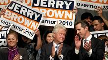 Bill Clinton and San Francisco Mayor Gavin Newsom, a Democratic candidate for lieutenant-governor, at a rally for gubernatorial contender Jerry Brown in San Jose, Oct. 17. (Robert Gailbraith/Reuters/Robert Gailbraith/Reuters)
