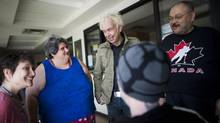 Former Portland Hotel Society executive director Mark Townsend, second from right, catches up with some of the first people he worked with in the Downtown Eastside over 20 years ago at Woodward's Housing run by PHS Community Services Vancouver on March 23, 2014. (Rafal Gerszak for the Globe and Mail)