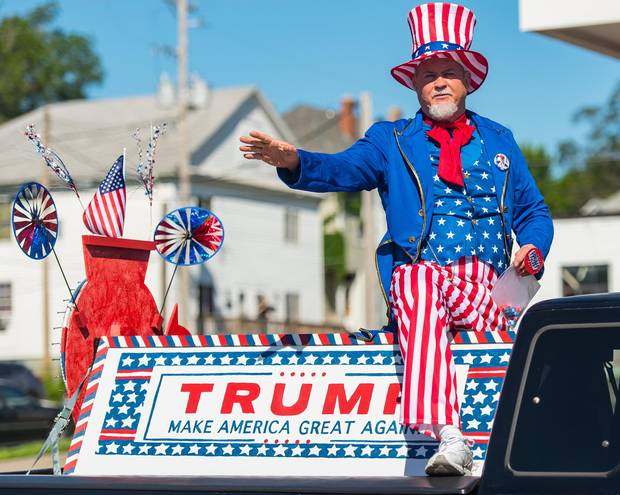 A man dressed as Uncle Sam rides a Donald Trump float during the Northside June Festival Parade on June 4 in St. Joseph, Missouri.