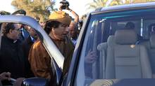 Libyan leader Moammar Gadhafi gets into his car in the compound of Bab Al Azizia in Tripoli, after a meeting with a delegation of five African leaders seeking to mediate in Libya's conflict, April 10, 2011. (Louafi Larbi/Reuters/Louafi Larbi/Reuters)