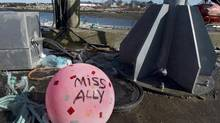 A buoy from the ill-fated fishing boat Miss Ally rests on the dock in Woods Harbour, N.S., on Feb. 19, 2013. (Andrew Vaughan/The Canadian Press)