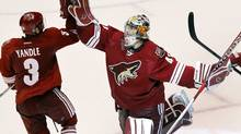 Phoenix Coyotes goalie Mike Smith, right, celebrates their 5-3 win over the Nashville Predators with Keith Yandle after Game 2, Sunday, April 29, 2012, in Glendale, Ariz. The Coyotes won 5-3. (Ross D. Franklin/Ross D. Franklin/AP)