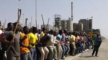 The strike at Lonmin's Marikana mine is now entering its second month and has a death toll of at least 34. (Denis Farrell/ASSOCIATED PRESS)