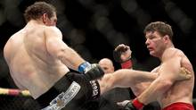 Michael Bisping, right, of England, and Tim Kennedy, of Austin, Texas, fight, Wednesday, April 16, 2014 at the UFC Fight Night in Quebec City. Kennedy won the fight. (Jacques Boissinot/THE CANADIAN PRESS)