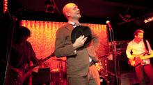 The Tragically Hip perform three songs Oct 1, 2012 at a small club in Toronto's Kensington Market. Singer Gord Downie with guitarist Paul Langlois, bass player Gord Sinclar, Johnny Fau on drums and Rob Baker on guitar. (Moe Doiron/The Globe and Mail)