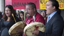 Brittmey Picody, Brad Picody and Brock Lewis drum as Idle No More protesters gather in Gatineau, Que., as part of a worldwide mass day of action on the 250th anniversary of the Royal Proclamation on Oct. 7, 2013. (JUSTIN TANG/THE CANADIAN PRESS)