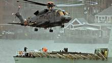 A Sikorsky CH-148 Cyclone conducts test flights with HMCS Montreal in Halifax Harbour on April 1, 2010. (Andrew Vaughan/The Canadian Press)