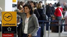 Passengers queue in front of Lufthansa counters at Berlin Tegel airport, March 21, 2013 after German carrier Lufthansa cancelled around 700 flights due to a massive strike. (Michael Sohn/AP)