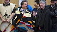 Assembly of First Nations national chief Shawn Atleo and his wife, Nancy, take part in ceremonies prior to a meeting of B.C. chiefs in Vancouver on Jan. 24, 2013. (ANDY CLARK/REUTERS)