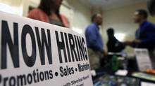 In this photo taken Oct. 25, 2012, a sign attracts job seekers during a job fair at the Marriott Hotel in Colonie, N.Y. (Mike Groll/AP)