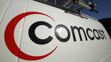 This Feb. 11, 2011 file photo shows the Comcast logo on one of the company's vehicles, in Pittsburgh. (Gene J. Puskar/AP)