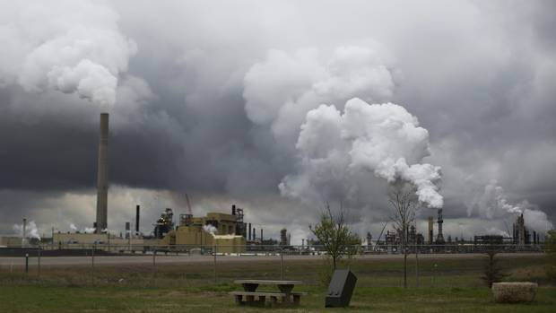 A picnic table overlooks Syncrude's Mildred Lake oil sands upgrader north of Fort McMurray, Alberta on Tuesday, May 27, 2014. (Amber Bracken for The Globe and Mail)