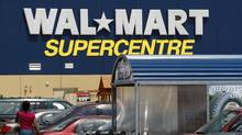 Customers head in and out of a Walmart Supercentre location in Scarborough, Ontario (Deborah Baic/The Globe and Mail)