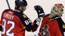 Florida Panthers' Tomas Kopecky (L) congratulates goalie Jose Theodore (R) on his shutout against the New Jersey Devils following their NHL Eastern conference quarterfinal playoff hockey Game 5 in Sunrise, Florida Apr