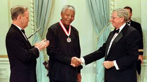 <p>Mr. Mandela shakes hands with former govenor-general Romeo LeBlanc as then prime minister Jean Chretien looks on. Nelson Mandela received his honorary Companion of the Order of Canada at a ceremony at Ridea
