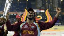 West Indies' Chris Gayle celebrates with the trophy after the West Indies defeated Sri Lanka in their World Twenty20 final cricket match at R Premadasa stadium in Colombo October 7, 2012. (PHILIP BROWN/REUTERS)