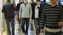 Shoppers at a Toronto mall in a file photo form 2011. Average weekly earnings of non-farm payroll workers are up 3.6 per cent on a year-over-year basis. Given that the inflation rate is now just 1.8 per cent, that means that wages are up in 'real' terms. (Kevin Van Paassen/The Globe and Mail)