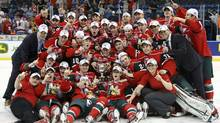 The Halifax Mooseheads celebrate with the Memorial Cup trophy after they defeated the Portland Winterhawks to win the Canadian Junior Hockey Championships Memorial Cup final in Saskatoon, Saskatchewan, May 26, 2013. (Reuters)