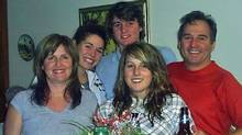 A family photo shows Marie-Jose Fortin, left, and Gilles Blackburn, right, with their son's girlfriend Amelie Jeanneau, second left, their son William Blackburn and their daughter Laurence Blackburn.