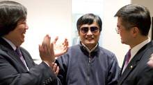 A handout photo from US Embassy Beijing Press office shows blind activist Chen Guangcheng (C) shaking hands with U.S. Ambassador to China Gary Locke (R), in Beijing, May 2, 2012. (HANDOUT/REUTERS)
