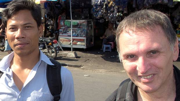 Canadian Dave Walker, right, and Cambodian Sonny Chhoun visiting Phnom Penh, Cambodia, in 2013.