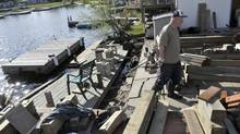 Paul Hamill repairs his flood damaged dock at Deer Lake Resort Park just outside of Huntsville, May 17, 2013. Hamill, who lives in NewMarket, will spend most of his long weekend making repairs to both his dock and flood damaged cottage. (J.P. MOCZULSKI for The Globe and Mail)