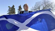MMF president David Chartrand with the Metis Infinity Flag (Robert Tinker/Robert Tinker)