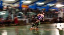 Here the photographer uses a slow shutter while panning with a rollergirl as she flies around the track during a roller derby. (Brett Beadle/The Globe and Mail/Brett Beadle/The Globe and Mail)