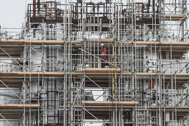 The Sturgeon Refinery northwest of Edmonton still employs more than 5,000 construction workers with a goal of having it processing oil sands crude into low-sulphur diesel before Christmas.