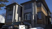 A Ontario Provincial Police vehicle sits outside the Ottawa home of Col. Russell Williams on Feb. 9, 2010. (Pawel Dwulit/The Canadian Press) (Pawel Dwulit)