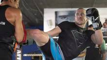 UFC welterweight champion Georges St-Pierre trains on Monday, October 28, 2013 in Montreal for his upcoming fight against Johnny Hendricks. (The Canadian Press)