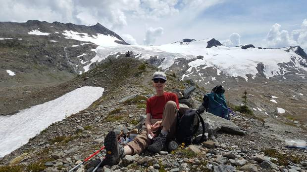 Annelies Ebner on a break from hiking in the Selkirk Mountains of British Columbia, the Allalin Glacier behind her.