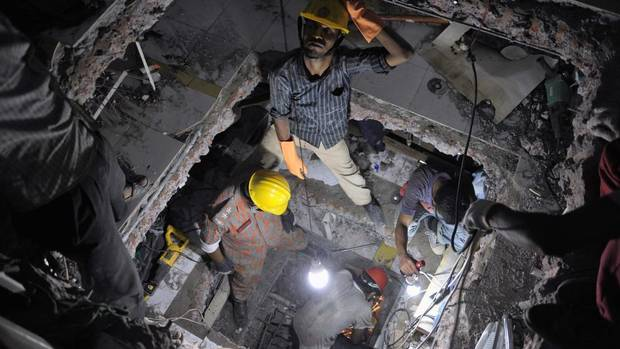 Rescue workers attempt to rescue garment workers from the rubble of the collapsed Rana Plaza building. (REUTERS)
