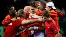 Canada's Milos Raonic, of Toronto, Ont., is mobbed by his teammates after defeating Spain's Guillermo Garcia-Lopez during a Davis Cup tennis world group first-round tie singles match in Vancouver, B.C., on Sunday February 3, 2013. The victory gave Canada a win over Spain in the first round tie and they advance to the next round of the Davis Cup. (Darryl Dyck/THE CANADIAN PRESS)